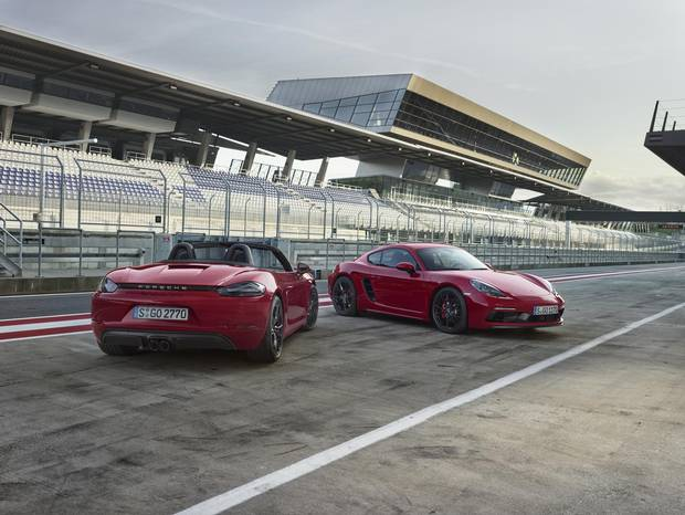 The 2018 Porsche Boxster GTS, left, and 718 Cayman.