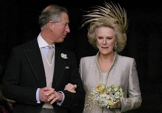 Prince Charles and The Duchess of Cornwall leave St. George's Chapel in Windsor Castle, southern England, following the Service of Prayer and Dedication following their marriage, April 9, 2005. Prince Charles and his long-term partner Camilla Parker Bowles, who became Her Royal Highness the Duchess of Cornwall on their marriage, married on Saturday in a low-key ceremony.