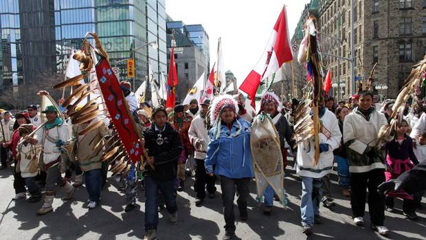"The walkers of Nishiyuu – a Cree word meaning ""the people"" – make their way to Parliament Hill in Ottawa on March 25, 2013. Nishiyuu began as a journey on foot by seven people from the northern Quebec reserve of Whapmagoostui to Ottawa, but some 300 people joined the walkers along their two-month trek. (DAVE CHAN FOR THE GLOBE AND MAIL)"