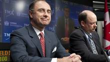 Xavier Rolet, left, CEO of the London Stock Exchange, and Thomas Kloet, CEO of TMX Group, appear at a press conference in Toronto on Feb. 9 to announce the proposed merger of the exchange groups. (Chris Young/Chris Young/The Canadian Press)