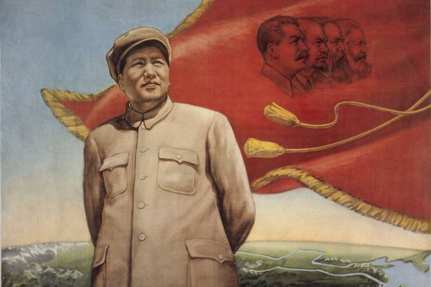 A propaganda poster from the 1950s shows Mao Zedong standing in front of a red flag with portraits of Stalin, Lenin, Engels and Marx.