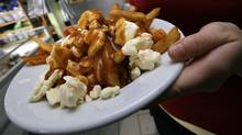 A serving of poutine heads out to a customer at La Formagerie du Village in Warwick, Quebec. (Deborah Baic)