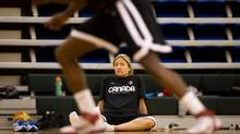 Canadian women's national basketball team guard Teresa Gabriele ices her knee while watching her teammates practice at the University of the Fraser Valley in Abbotsford, B.C., on Wednesday May 16, 2012. (Darryl Dyck for The Globe and Mail)