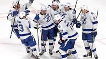 Tampa Bay Lightning celebrate their win against Montreal Canadiens after an overtime period at Bell Centre. (Jean-Yves Ahern/USA Today Sports)