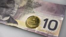 A Canadian loonie and $10 bill. (Fred Lum/The Globe and Mail)