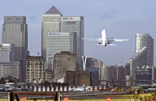 A British Airways plane takes off at London City Airport.