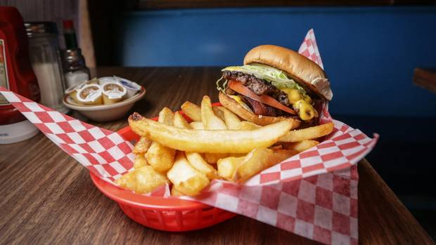 Banquet Burgers, stacked with cheese, bacon, lettuce and tomato are one of the favourite dishes at Harry's.