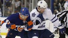 Toronto Maple Leafs Tyler Bozak fights for the puck with the New York Islanders Michael Grabner during the first period of their NHL hockey game in Uniondale, New York, March 8, 2011. (Reuters)
