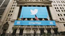A sign displays the Twitter logo on the front of the New York Stock Exchange ahead of the company's IPO in New York, November 7, 2013. (LUCAS JACKSON/REUTERS)