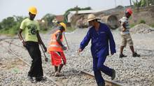 Within BRICS, it is China that is most often seen as Africa's saviour. Here, a Chinese contractor, foreground, points to a spot on a railway track for a labourer to work on in Lagos. (Sunday Alamba/AP)