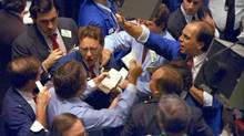 Traders on the floor of the New York Stock Exchange work frantically as panic selling swept Wall Street on Oct. 19, 1987. (PETER MORGAN/AP)
