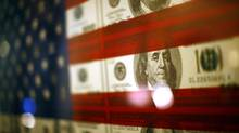 An American flag that incorporates 100 dollar bills is seen at the Museum of American Finance in New York on Sept. 18, 2008. (Eric Thayer/Reuters)