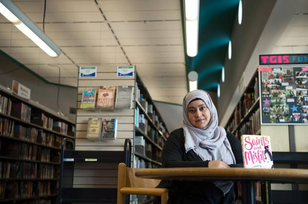 Author Sajidah Ali, who recently published 'Saints and Misfits,' a book aimed at teens, poses for a portrait at the Pickering public library, Wednesday, July 26, 2017.