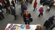 A job seeker, centre, is pictured at a career fair in Denver on April 9, 2013. (Rick Wilking/Reuters)