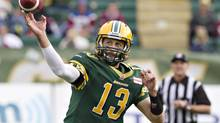 Edmonton Eskimos Mike Reilly (13) makes the throw against the Montreal Alouettes during first half action in Edmonton, Alta., on Saturday October 5, 2013. (JASON FRANSON/THE CANADIAN PRESS)
