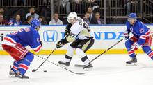 New York Rangers defensemen Dan Girardi and Ryan McDonagh don't seem to have any answers for Pittsburgh Penguins center Sidney Crosby (Brad Penner/USA Today Sports)