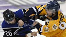 Saint John Sea Dogs Grant West, left, and Shawinigan Cataractes Vincent Arseneau fight during third period Memorial Cup action in Shawinigan Que., on Wednesday, May 23, 2012. (Jacques Boissinot/The Canadian Press)