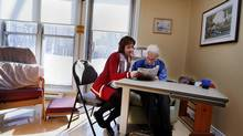 Teresa Dellar, executive director of the West Island Palliative Care Residence, with hospice resident Francis Young, 85. (Christinne Muschi for The Globe and Mail)