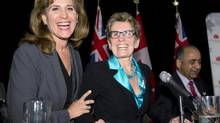 Ontario Liberal leadership candidates Sandra Pupatello, left, and Kathleen Wynne share a laugh following a forum at the Canadian Club of Toronto, Dec. 6, 2012. (Frank Gunn/THE CANADIAN PRESS)