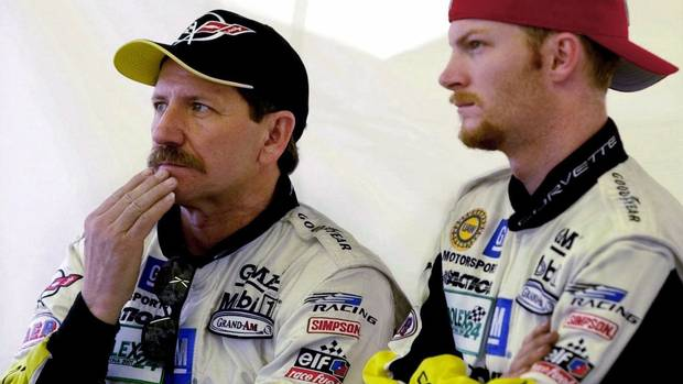 7 Dale Earnhardt, left, and his son Dale Earnhardt, Jr., right, from Kannapolis, N.C., watch from the pit area at Daytona International Speedway as their GTS class Corvette powers through the grandstand straightaway Thursday, Feb. 1, 2001, in Daytona Beach, Fla. Earnhardt Sr., one of the greatest stars in auto racing history, died Sunday from injuries in a last-lap crash at the Daytona 500, NASCAR officials said.Daytona.(AP Photo/Amy Conn)