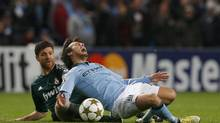 Manchester City's David Silva is fouled by Real Madrid's Xabi Alonso during their Champions League Group D soccer match at The Etihad Stadium in Manchester, northern England November 21, 2012. (PHIL NOBLE/REUTERS)