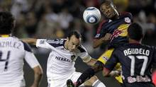 Los Angeles Galaxy forward Landon Donovan, centre, and New York Red Bulls midfielder Dane Richards head the ball during the second game of an MLS soccer Western Conference semifinal at Home Depot Center in Carson, Calif., on Nov. 3, 2011. (Jae Hong/AP)