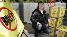 Katy Butler, a high-school student from Michigan and a onetime target of bullying, poses with boxes containing more than 210,000 petition signatures that she is delivering to the Los Angeles office of the Motion Picture Association of America to urge the MPAA to lower the rating of the documentary Bully from R to PG-13, in Los Angeles, March 7, 2012. (Jonathan Alcorn/Reuters)