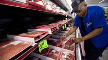 In this May 21, 2014, file photo, Briaen Steele shops for meat at Kovac's Grocery Store in St. Joseph, Mo. (Sait Serkan Gurbuz/AP)