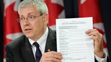 NDP MP Charlie Angus releases municipal files on the Conservative government's spending in advance of the 2010 Muskoka G8 summit at an Ottawa news confderence on Aug. 15, 2011. (Sean Kilpatrick/THE CANADIAN PRESS)