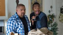 Gabriel Iglesias and Marlon Wayans (stars as Malcolm) in A Haunted House 2 (2014). (WIll McGarry/VVS Media)