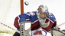 Colorado Avalanche Patrick Roy keeps his eyes on the puck as he makes a save against the Montreal Canadiens during first period NHL action in Montreal Tuesday Nov. 6, 2001. (RYAN REMIORZ/Ryan Remiorz/The Canadian Press)