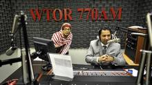 Yudhvir Jaswal, right, with technician Waheeda Majid, hosts prominent federal politicians on his South Asian Pulse radio show. (J.P. MOCZULSKI For The Globe and Mail)