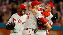 Philadelphia Phillies starting pitcher Roy Halladay, centre, celebrates with Carlos Ruiz, right, and Ryan Howard after Halladay threw a perfect game against the Florida Marlins May 29, 2010 in Miami. (Wilfredo Lee)