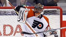 Philadelphia Flyers goalie Brian Boucher makes a save during the third period of their NHL hockey game against the Toronto Maple Leafs in Toronto April 6, 2010. REUTERS/ Mike Cassese (MIKE CASSESE)