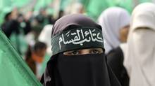 A Hamas supporter attends a rally in Gaza City, December 14, 2011. In a rare interview with U.S. Jewish newspaper Forward, Hamas official Mousa Abu Marzook spoke of the difficulty of governing Hamas (IBRAHEEM ABU MUSTAFA/REUTERS/IBRAHEEM ABU MUSTAFA/REUTERS)