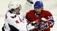 Washington Capitals Alex Ovechkin, left, checks Montreal Canadiens Tomas Plekanec during first period Game 3 NHL Eastern Conference quarter-finals hockey action Monday, April 19, 2010 in Montreal. (Ryan Remiorz/THE CANADIAN PRESS)