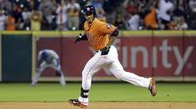 Houston Astros' Gregorio Petit (3) looks back toward the dugout as he runs the bases after hitting a home run against the Toronto Blue Jays during the eighth inning of a baseball game Friday, Aug. 1, 2014, in Houston. (David J. Phillip/Associated Press)