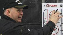 Boston Bruins head coach Claude Julien draws a play on a diagram during hockey practice in Wilmington, Mass., Tuesday, April 12, 2011. (AP Photo/Charles Krupa) (Charles Krupa/AP)