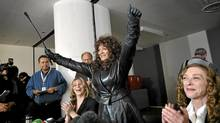 Left to right sex worker advocate Terri-Jean Bedford raises her arms in victory during a press conference in Toronto, Ont. Monday, March 26, 2012. Ontario,ÄöaÑa¥s top court has legalized brothels in a ruling that came out today. (Kevin Van Paassen/The Globe and Mail/Kevin Van Paassen/The Globe and Mail)