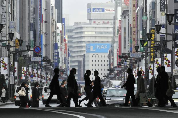 Pedestrians cross a street in Tokyo's Ginza shopping district in 2008.