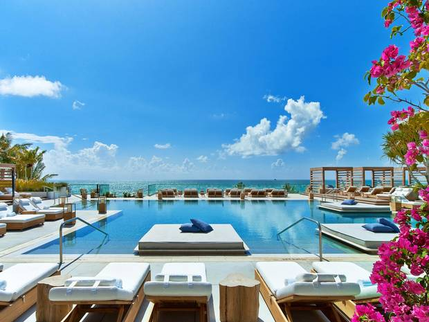 Four swimming pools overlook the ocean.