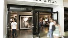 In this Aug. 12, 2008 file photo, shoppers walk in front of a Abercrombie & Fitch store in San Jose, Calif. (Paul Sakuma/AP)