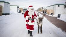 Santa paid a visit to Saddlebrook, where some 500 residents have been living in temporary housing since their town of High River was devastated by floods last June. (Chris Bolin For The Globe and Mail)