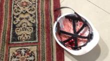 One bloodied helmet on floor of Hotel Ukraine lobby. (Paul Waldie/The Globe and Mail)