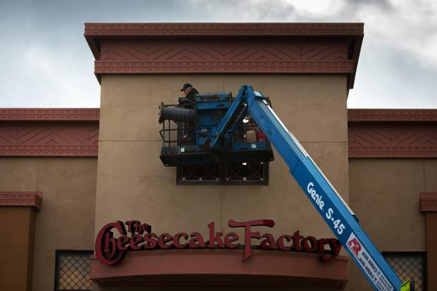 The finishing touches are put on the facade of the Cheesecake Factory at the Yorkdale Shopping Centre where the U.S. chain restaurant is opening its first Canadian location.