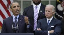 U.S. President Barack Obama speaks alongside Vice President Joe Biden and Jimmy Greene, father of slain Sandy Hook student Anna Marquez-Greene, on efforts to reduce gun violence in the Rose Garden of the White House in Washington, April 17, 2013. Joined by relatives of the victims of gun violence, Obama on Wednesday angrily blamed politics for the failure of gun control legislation and urged voters to send a message at the ballot box that they want stronger gun laws. (YURI GRIPAS/REUTERS)