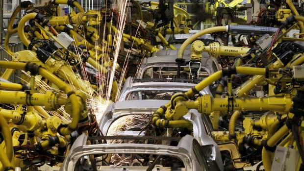 Robotic machines weld bodies of cars in Kia Motors Corp.'s factory in Zilina, 200 kilometres north of Bratislava, Slovakia, on Oct. 3, 2012. Carmakers that cut costs last decade in Western Europe like Volkswagen AG, or those who were never saddled with expensive factories there, such as Korea's Hyundai Motor Co. and Kia, are now investing in new designs, conquering new markets and ramping up production, especially in Eastern Europe. (PETR JOSEK/REUTERS)