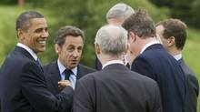 In this photo provided by the G8/G20 Summit U.S. President Barack Obama (L) and French President Nicolas Sarkozy (2nd L) joke with other G-8 leaders after posing for the leaders' group photo at the G-8 Summit on June 25, 2010 in Huntsville, Ontario, Canada. (Handout/Getty Images)