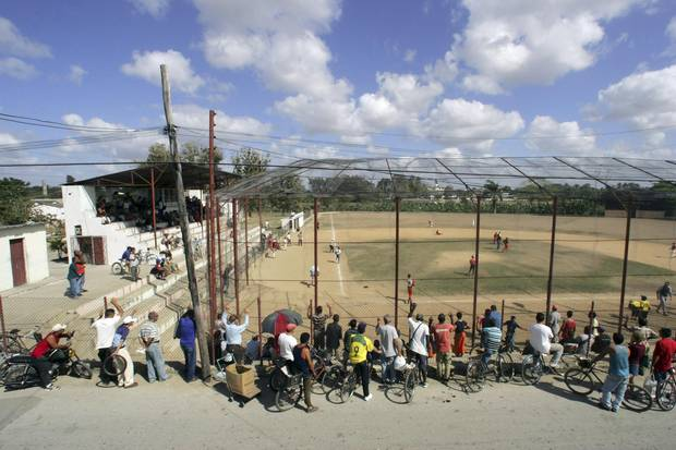 **FILE PHOTO** (NYT80) HAVANA, Cuba -- April 25, 2007 -- BBO-CUBA-2 -- Local residents watch a baseball game outside of Havana in this March 16, 2006 file photo. Major League Baseball officials are quietly preparing to re-establish the league's relationship with Cuba if the United States lifts its trade embargo on the island.
