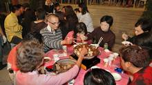 Locals dig in at a Hong Kong restaurant. (Hong Kong Tourism Board)